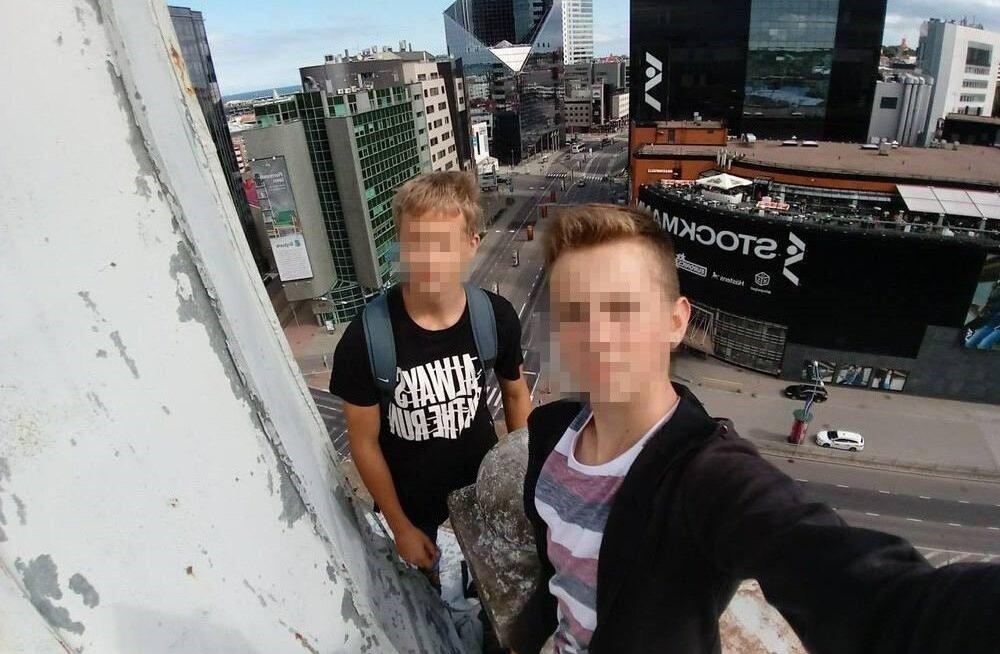 ФОТО: В Таллинне дети забрались на крышу высотки ради эффектного селфи