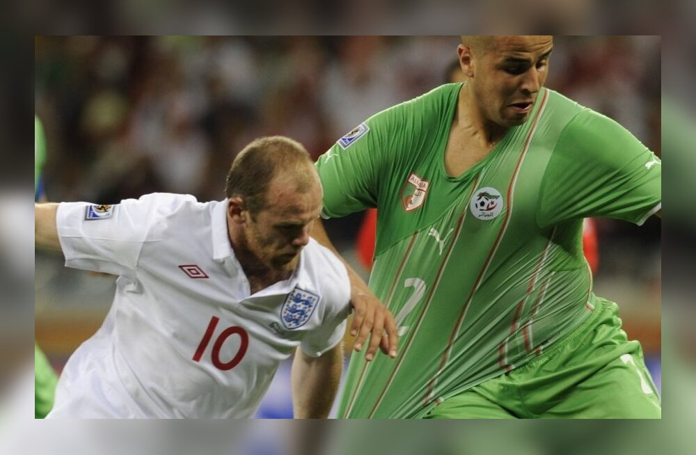 England's striker Wayne Rooney (L) challenges Algeria's defender Madjid Bougherra during the 2010 World Cup group C first round football match between England and Algeria on June 18, 2010 at Green Point stadium in Cape Town. NO PUSH TO MOBILE / MOBILE USE