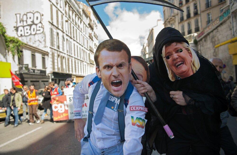 Macroni ja Le Peni maskidega meeleavaldajad Marseille' maiparaadil