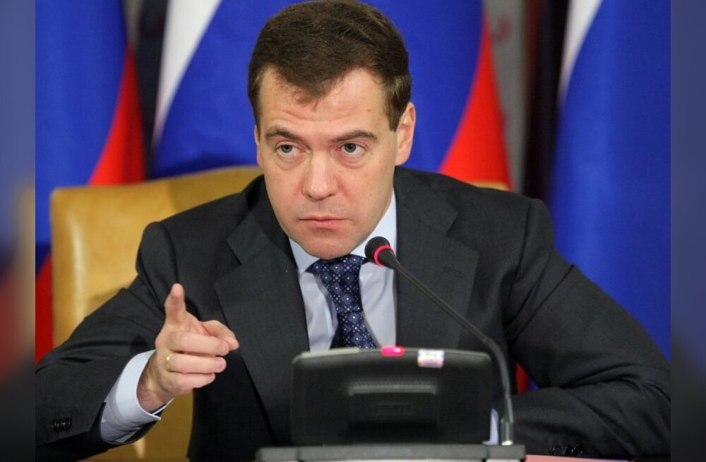 Russian President Dmitry Medvedev chairs a meeting of government officials in Gazprom headquarters in Moscow, Friday, Dec. 25, 2009. Medvedev on Friday lashed out at the country's giant state corporations for failing to develop new technologies to help mo