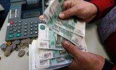 Рубль вырос на 55 копеек к доллару при открытии торгов во вторник