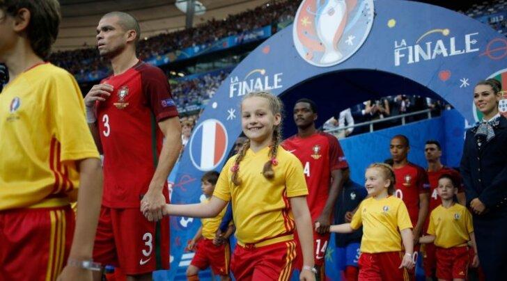 607136815 McDonald's player escorts at UEFA Euro 2016, Saint-Denis, France.